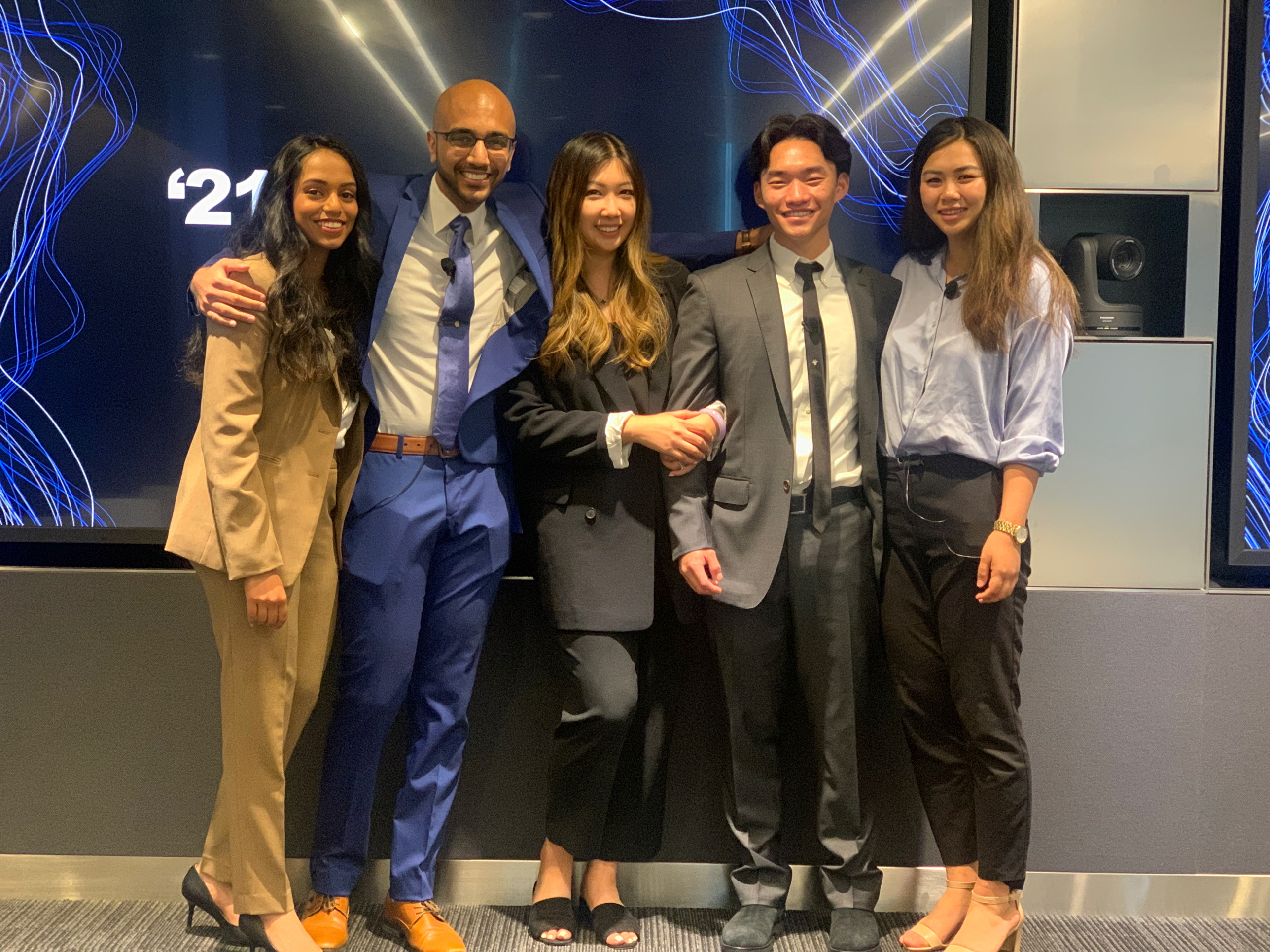 group photo of the 5 students on Team Bloomberg after their final presentation