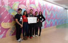 HCII students and faculty present fundraising check to UPMC Children's Hospital