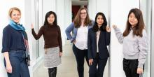Five female AI researchers stand in the bridge between NSH and Gates
