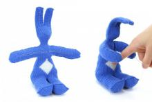 image on left: bunny knit out of blue yarn. image on right: when responsive fibers on belly are poked, bunny responds with hugging motion